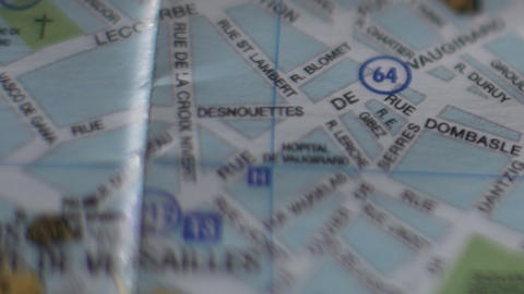 Closeup of French city map, tourist hand marking travel destination with pin Footage