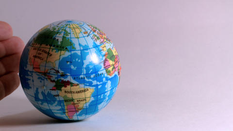 a hand of a man, caresses a globe, ideal footage to explain problems of ecology Footage