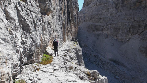 Male mountain climber, Dolomites Mountains in Italy. Travel adventure concept Live Action