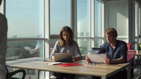 Employees discuss business strategy in the office Footage