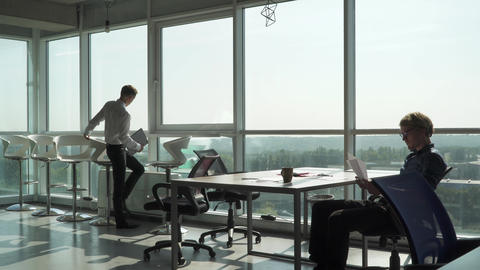 Office workers do their work in modern office Live Action