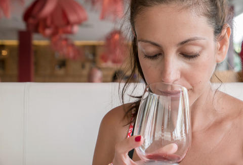 Young woman drinking wine Photo