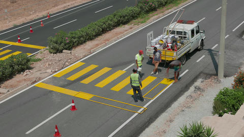 Painting of a new pedestrian crosswalk in progress. Time lapse, 4k Footage