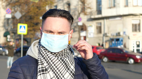 Man in mask in polluted city covered with heavy smog Live Action