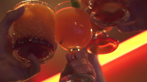 Human hands clink glasses with a cocktail ライブ動画
