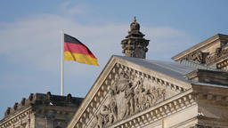 German Flag Upon The Reichstag in Berlin, Germany Fluttering In The Wind 영상물