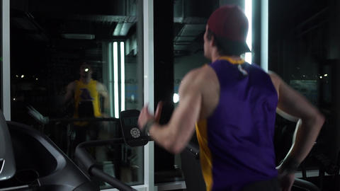 Mens movements of a arms on the treadmill Stock Video Footage