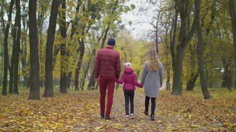 Happy patrents enjoying fresh air in autumn nature Live Action