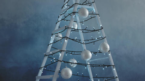 Stepladder decorated with garland, Christmas tree decorations Live Action