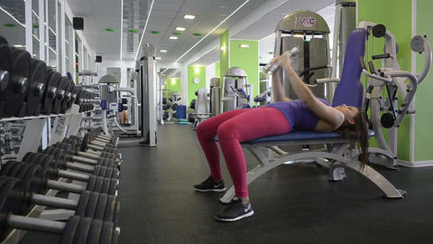Fitness woman exercising with dumpbells Footage