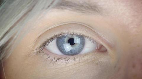 Cinemagraph - Blinking Female Eye Video Loop Super Closeup Footage