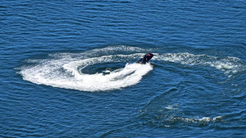 Man riding jet ski scooter over blue sea water Animación