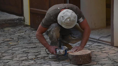 Man cutting ceramic tile with angle grinder GIF