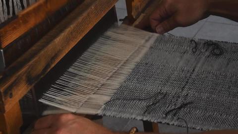 Close up man hands weave canvas ビデオ