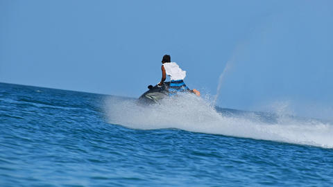 Young man riding jet ski over blue sea water Animation