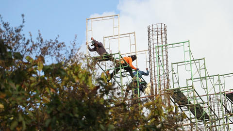 Construction workers are building scaffolding Footage