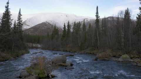 Beautiful view of the mountain river and mountains. Early morning, dawn Live Action