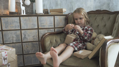 Little girl wraps a New Year's gift Footage