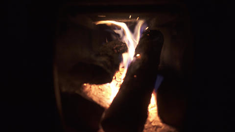 4K Relaxing warm firepit in a cold night in a small oven Footage