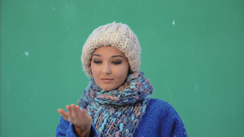 Happy woman having fun in winter. Falling snow. Winter holidays concept Live Action
