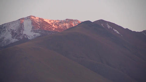 Mountain peaks in the snow, the setting sun, the greatness of the mountains Live Action