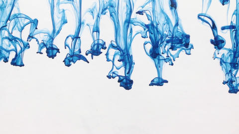 Chaotic movement of drops of blue paint in water. Abstract Footage