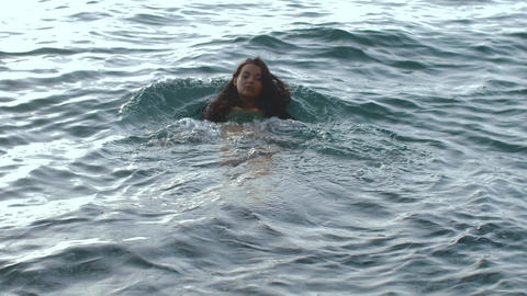 SLOW MOTION: Woman swimming in the sea Footage