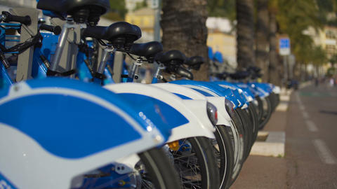 Blue eco-bicycles standing in row on street, bikes for hire, urban transport Archivo