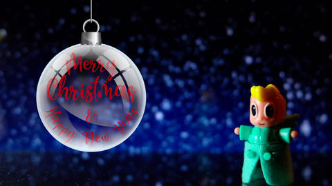 Toy Angel Merry Christmas and Happy New Year Front on snowing background Live Action