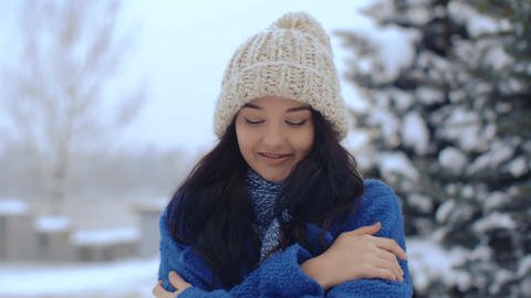 Young smiling woman winter portrait Stock Video Footage