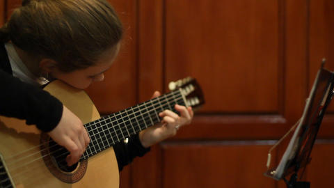 girl plays a guitar Stock Video Footage