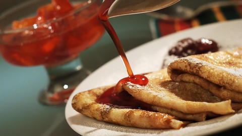 Pancake and strawberry syrup Stock Video Footage