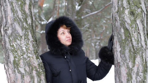 woman shows gesture in winter wood Stock Video Footage