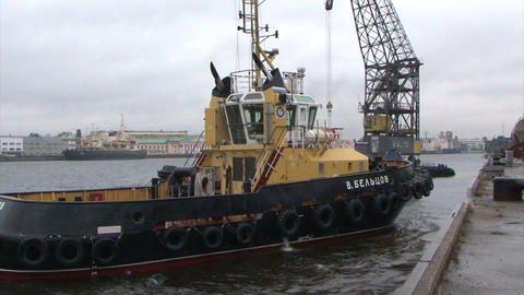 Tug-boat floats on the river Footage