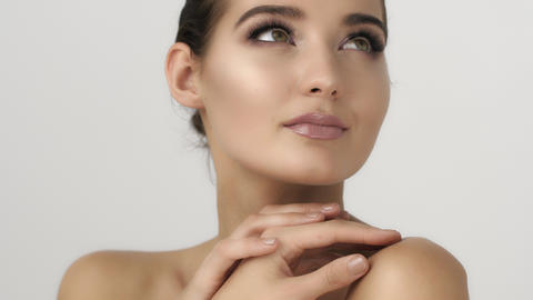 Portrait of beautiful and sexy woman on white. Skin care and cosmetics concept Footage