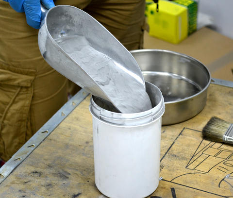 Metal powder pours into the container For laser sintering of metal Photo