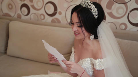Very beautiful bride opens and reads a letter from a loved one Footage