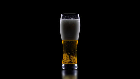 A glass of beer on a black background 영상물