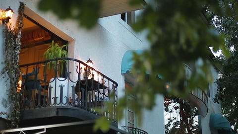 Comfortable balcony illuminated with lanterns, apartment for rent, real estate Footage