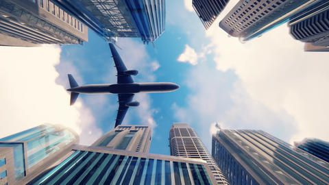 Airplane flies over a modern megapolis at sunrise in slow motion Animación