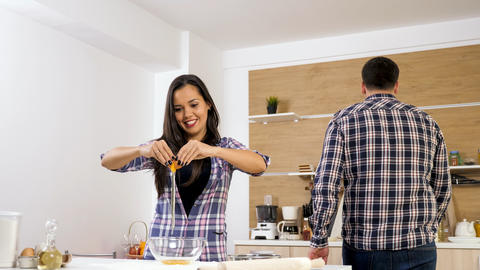 Cute joyful couple cooking together and spending time together Fotografía