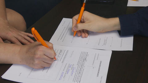 People Sign Contracts In Front of Each Other Live Action