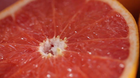 Juicy cut grapefruits on plate, prepared table for celebration catering closeup Live Action