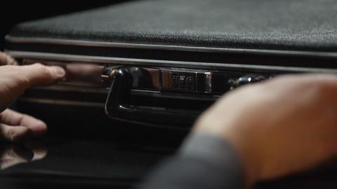 Oligarch hides cash money into suitcase, secret stash, no trust to bank, closeup Footage