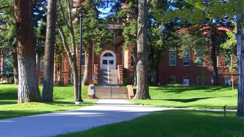 Academic Buildings, trees and green space on the campus of Northern Arizona Footage