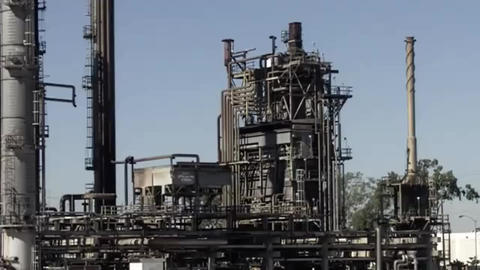Aging oil refining tower at an old refinery Footage