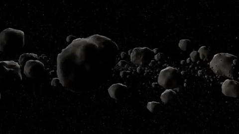 Asteroid field fly through on starry background Footage