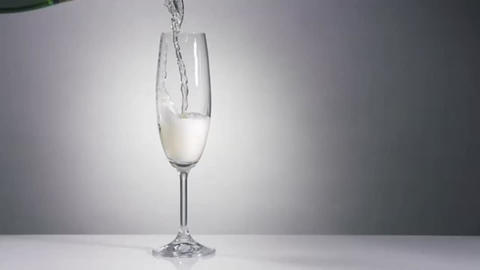 Champagne pouring in glass in slow motion Footage
