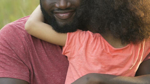 African father hugging his daughter, spending holiday together, family affection Live Action