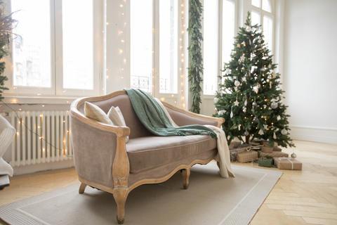 Sofa and Christmas tree near windows Photo